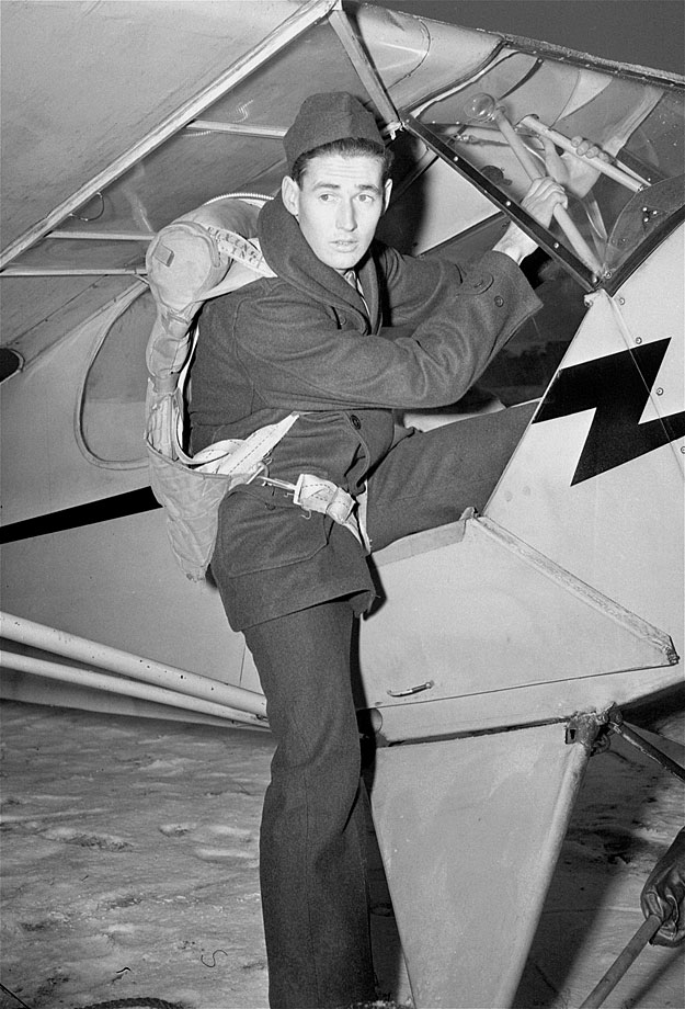 Fresh off his first Triple Crown, Ted Williams climbs into a plane in Amherst, Ma., as part of his Civilian Pilot training course in Dec. 1942.