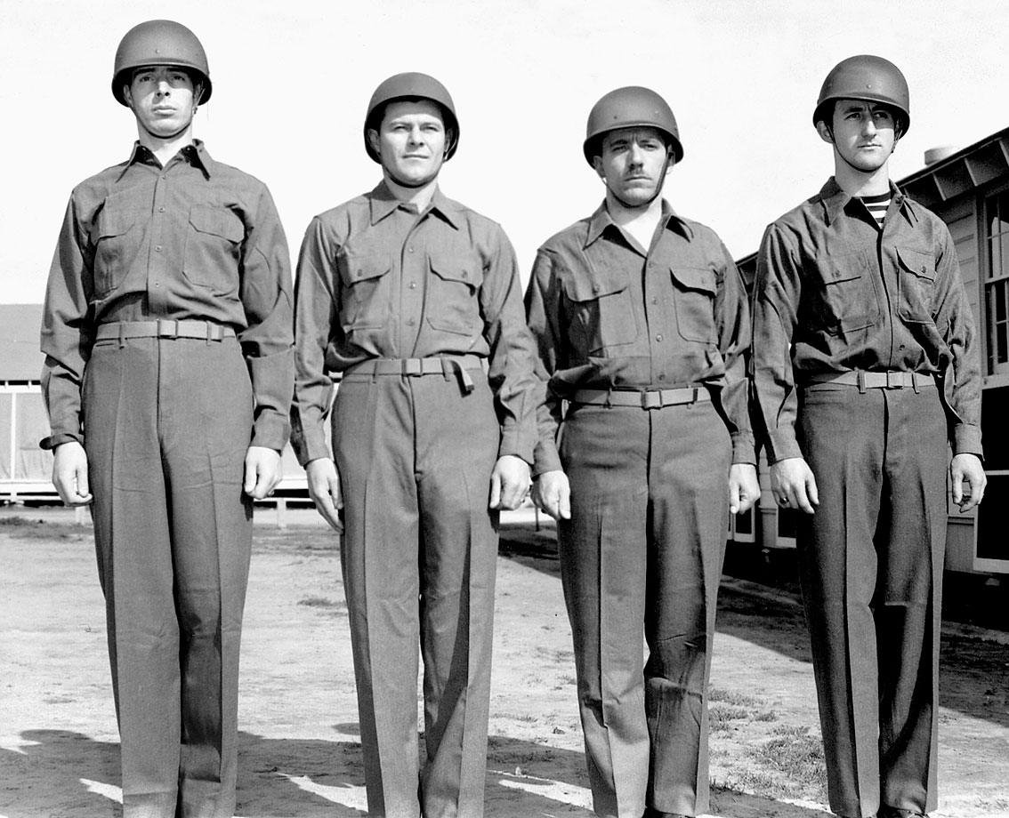 Joe DiMaggio stands at attention with his fellow US Army recruits after receiving his uniform on Feb. 18, 1943.