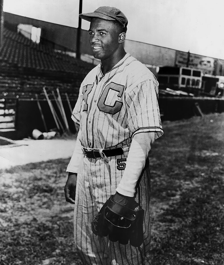 Jackie Robinson flashes a smile while playing shortstop for the Kansas City Monarchs of the Negro Leagues.