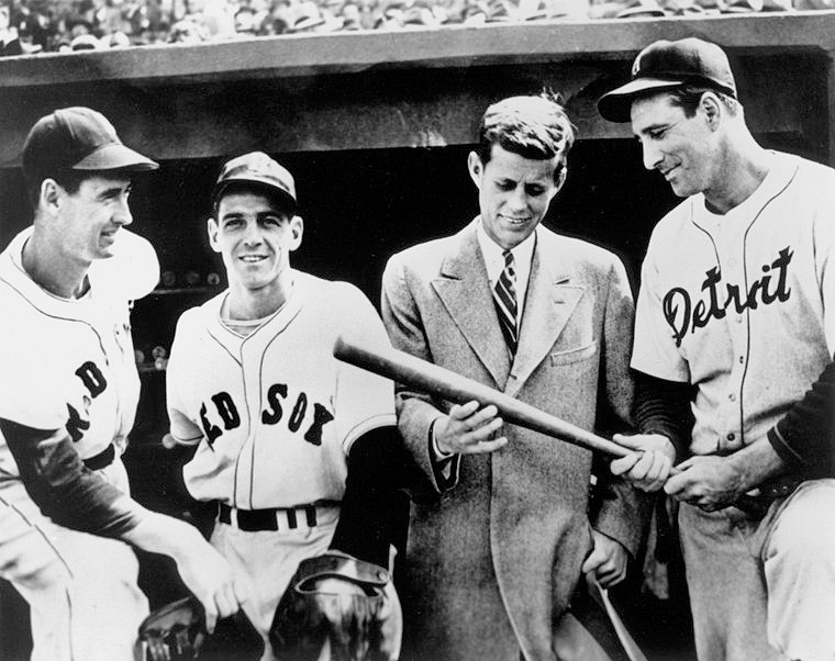 Ted Williams, Eddie Pellagrini, congressional candidate John F. Kennedy, and Hank Greenberg of the Detroit Tigers in the dugout before a game in 1946.
