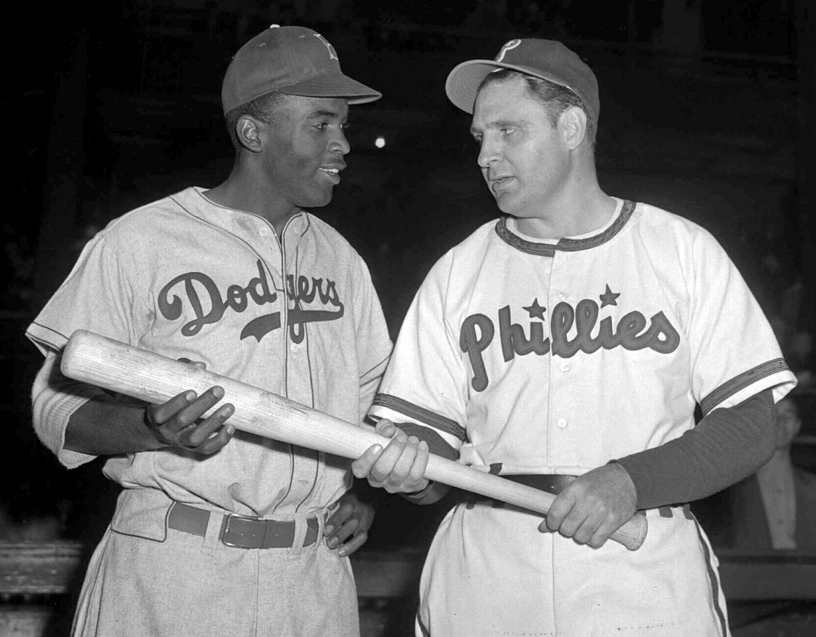 "Jackie Robinson poses with Phillies manager Ben Chapman before a game on May 9 ,1947. Weeks earlier, Chapman had shouted racist obscenities at Robinson from the Phillies dugout. Branch Rickey later recalled that Chapman ""did more than anybody to unite the Dodgers."""