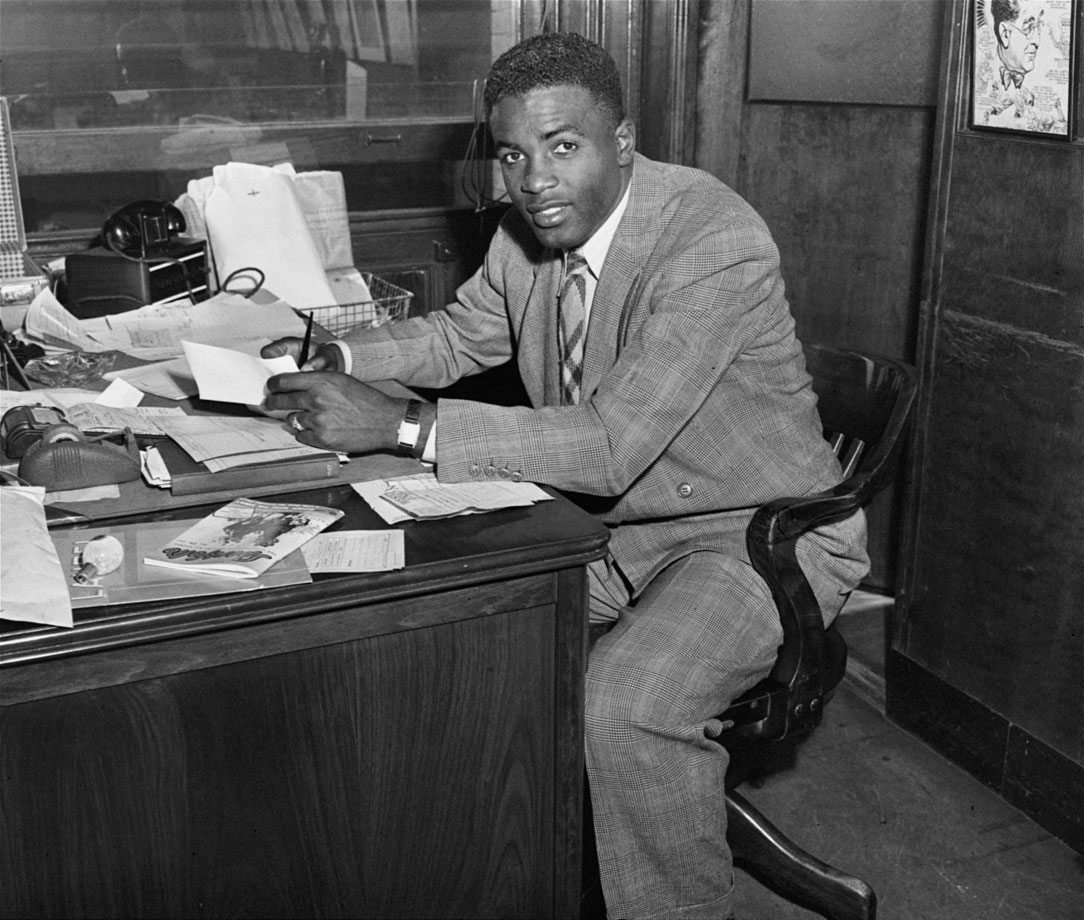 Jackie Robinson signs his contract to play for the Brooklyn Dodgers on April 10, 1947.