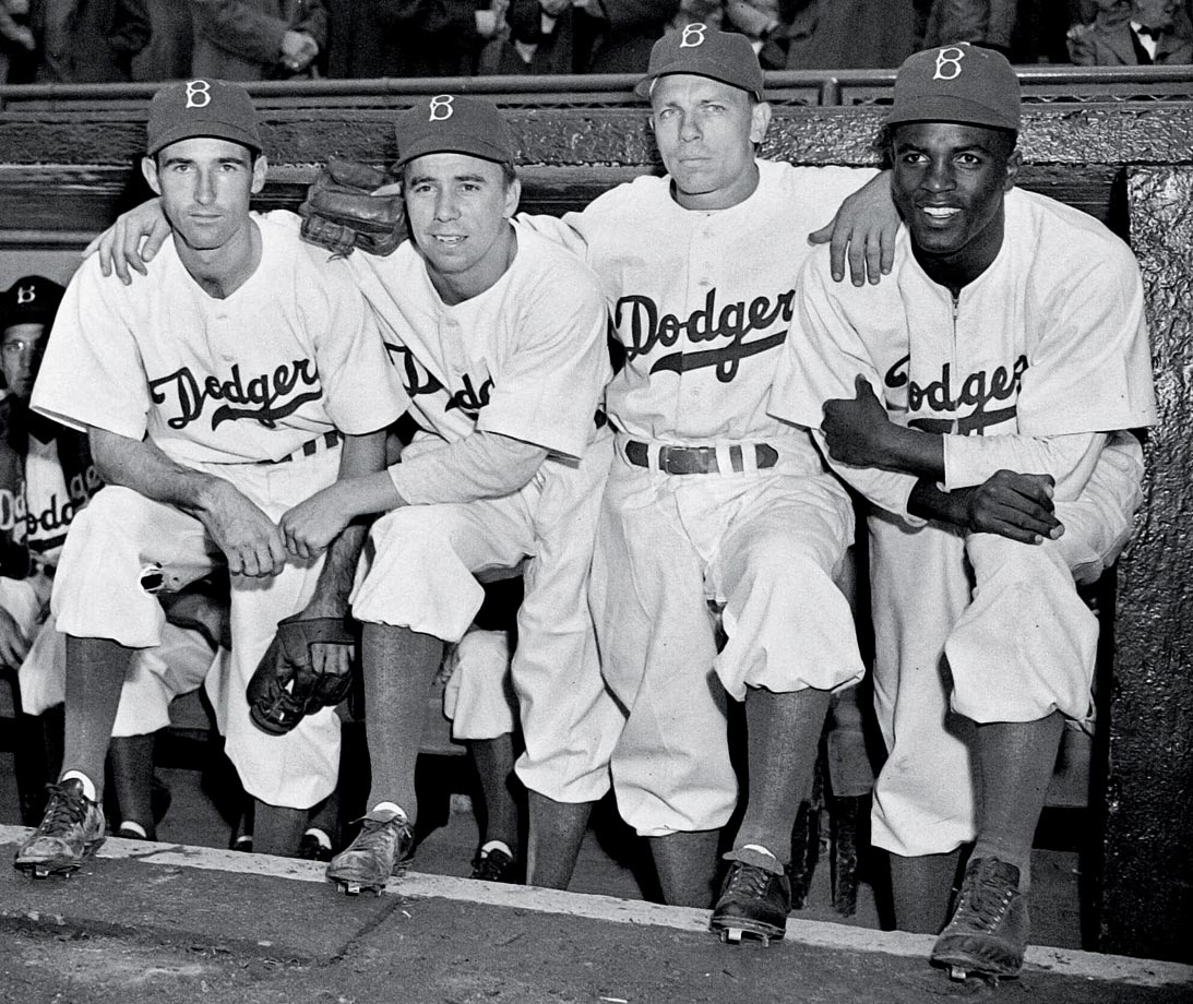 On April 15, 1947, Jackie Robinson's first day in the majors, he lined up with teammates (from left) John Jorgensen, Pee Wee Reese and Ed Stanky.
