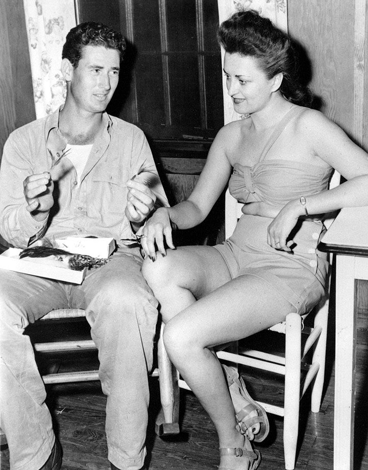 Ted Williams shows his wife Doris the home-made bait he used to catch a five-pound Tarpon in Miami in 1947.