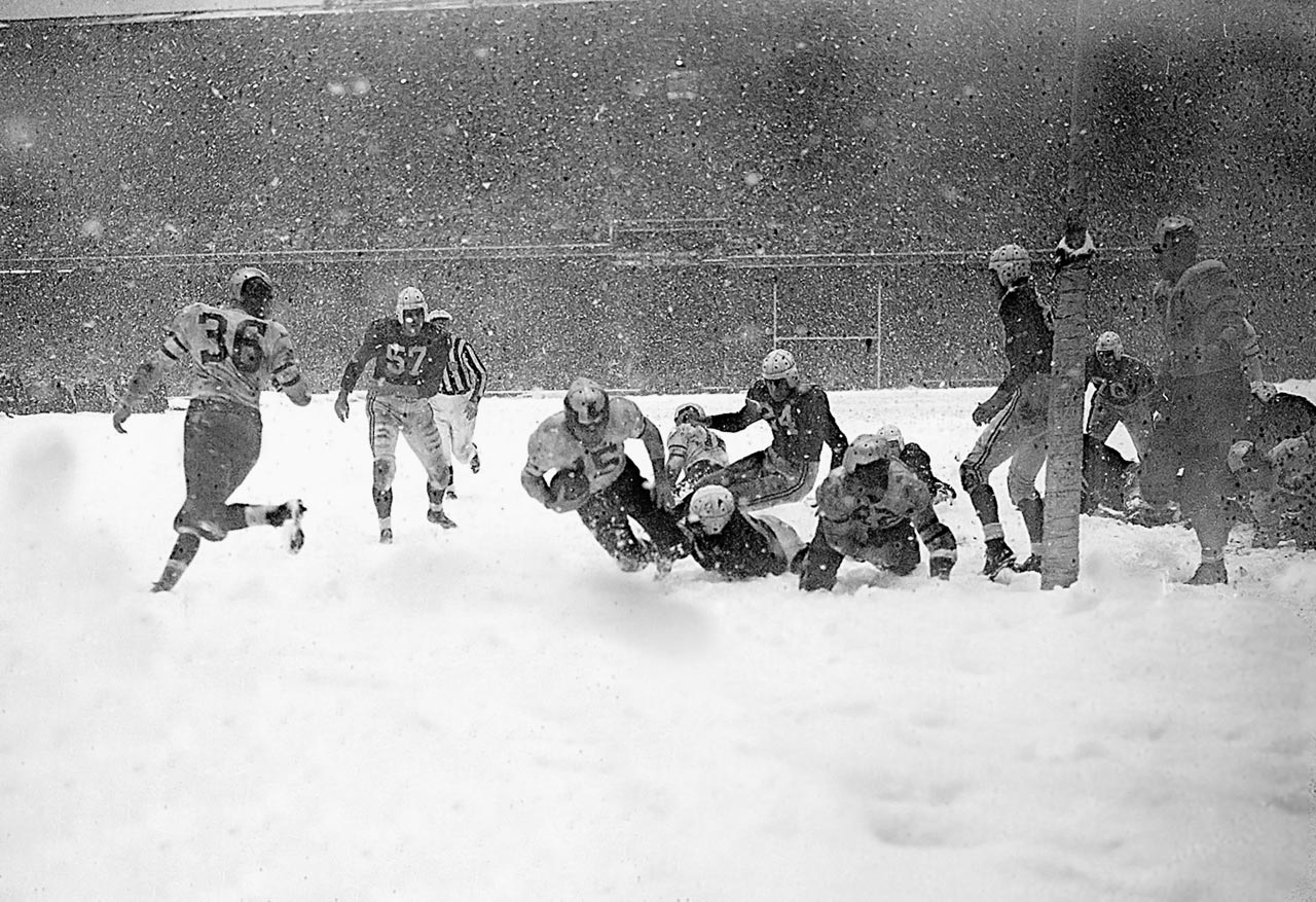 "It was the first NFL championship game to be televised. In the early days of television, ""snow"" was a frequent problem, but in this case the snow was real. The grounds crew needed the help of players from both teams to remove the tarp from the field, because of the heavy snowfall.  The teams played a scoreless game until early in the fourth quarter when, after Chicago had fumbled in their own end of the field, the Eagles recovered a fumble that set up Steve Van Buren's five yard touchdown and a 7-0 win for Philly."