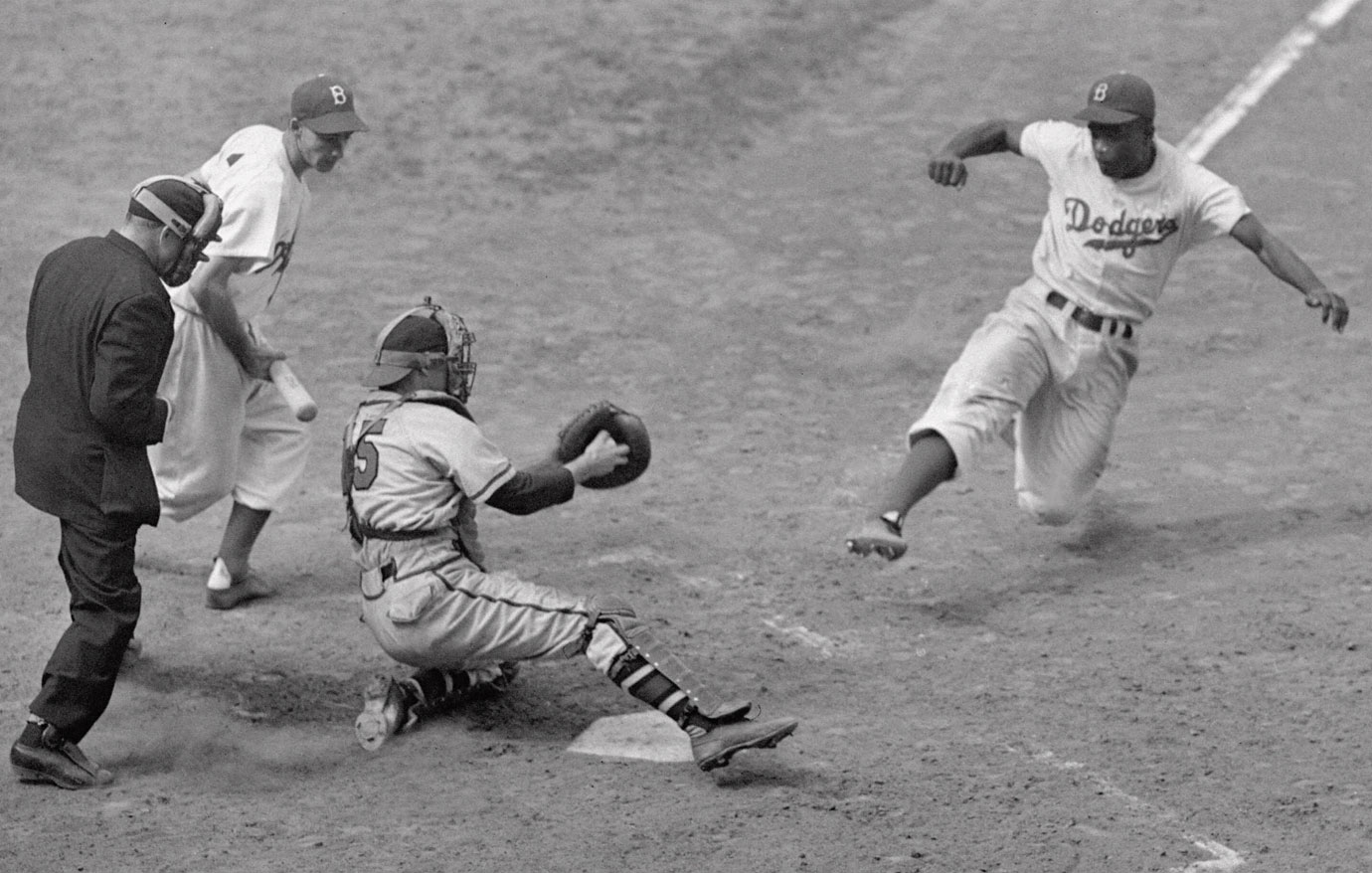 Jackie Robinson steals home against Braves pitcher Bill Voiselle and catcher Bill Salkeld on Aug. 22, 1948 at Ebbets Field.