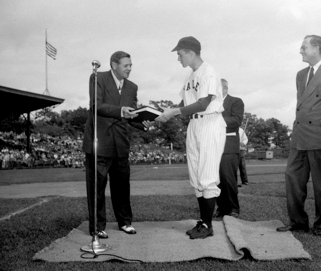 Babe Ruth presents Yale baseball captain George H. W. Bush the original manuscript of ''The Babe Ruth Story'' in June 1948 at Yale Field in New Haven, Conn.