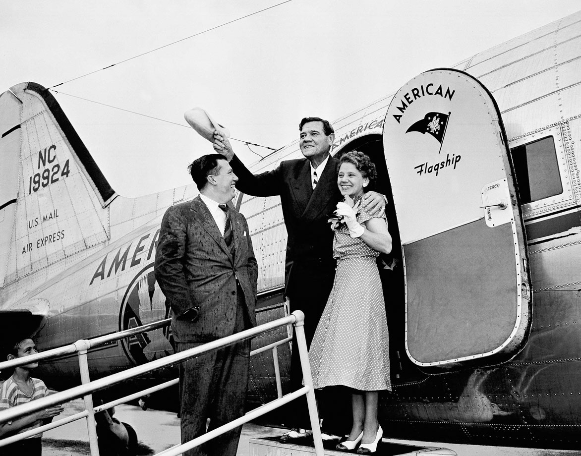 Babe Ruth waves his cap to the crowd on his arrival at the Municipal Airport in Baltimore with his sister Mary in July 1948.