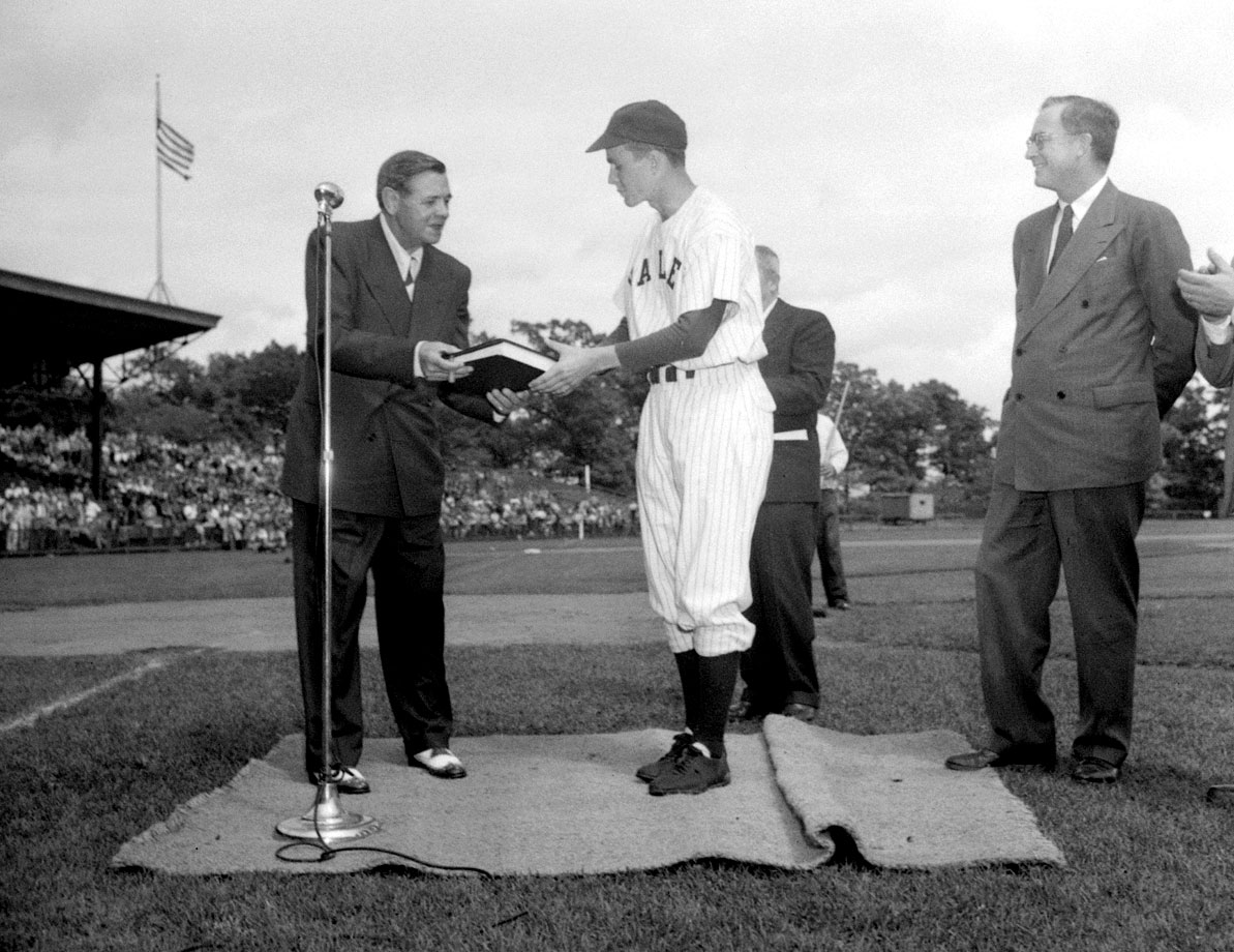 "Babe Ruth presents Yale baseball captain and first baseman George H. W. Bush the original manuscript of ""The Babe Ruth Story"" in 1948 at Yale Field in New Haven, Conn."