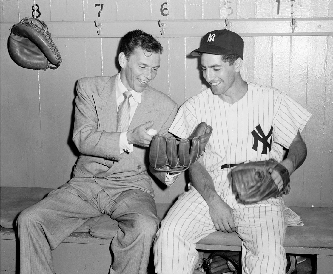 "Frank Sinatra shares a laugh with Phil Rizzuto in the dugout at Yankee Stadium in 1949.  Sinatra was preparing for a role as a baseball player in the upcoming film ""Take Me Out To The Ballgame."""