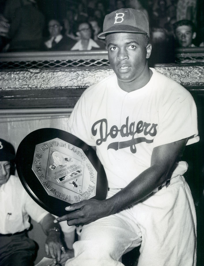 Jackie Robinson poses with his 1949 NL MVP award. Robison batted .342 with 16 home runs, 124 RBI and 37 stolen bases that season.