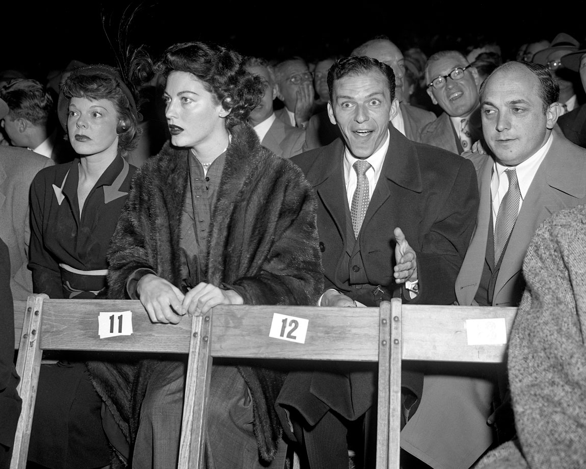 Ava Gardner and Frank Sinatra attend the Joe Louis vs. Ezzard Charles fight at Yankee Stadium on Sept. 27, 1950.