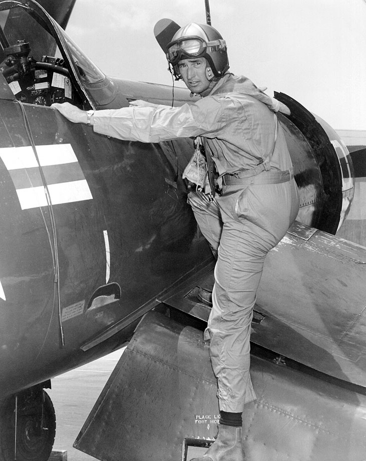 Ted Williams, now a Captain, climbs into a Corsair fighter plane in 1952.