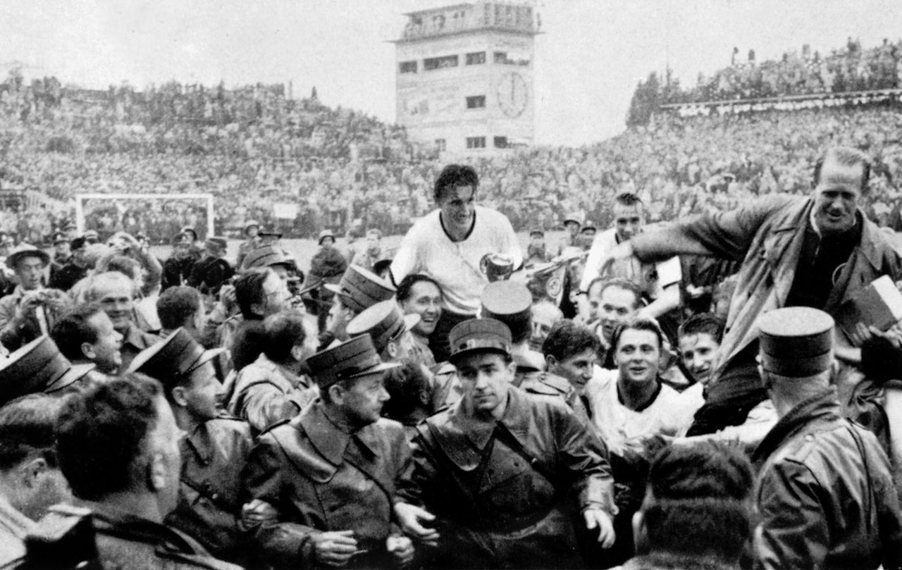 "German captain Fritz Walter and coach Sepp Herberger are hoisted on the shoulders of their compatriots after West Germany beat the heavily favored Hungarian team in the 1954 World Cup final, 3-2, nicknamed ""The Miracle of Bern."""