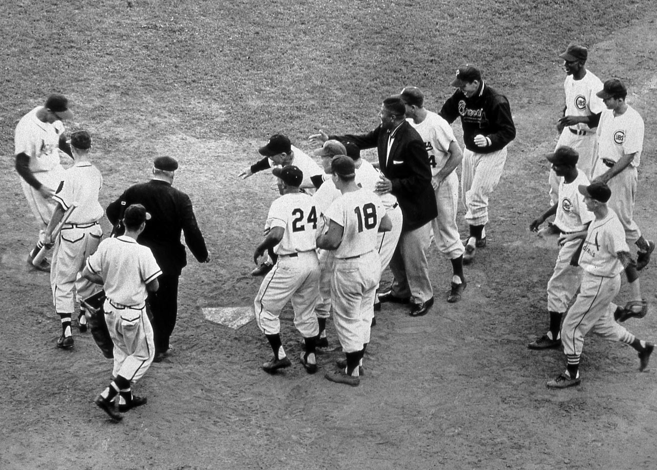 Stan Musial (left) broke a 5-5 tie with his walk-off home run in the 12th inning to cap a late comeback in Milwaukee by the National League, which had been down 5-0 through six innings.