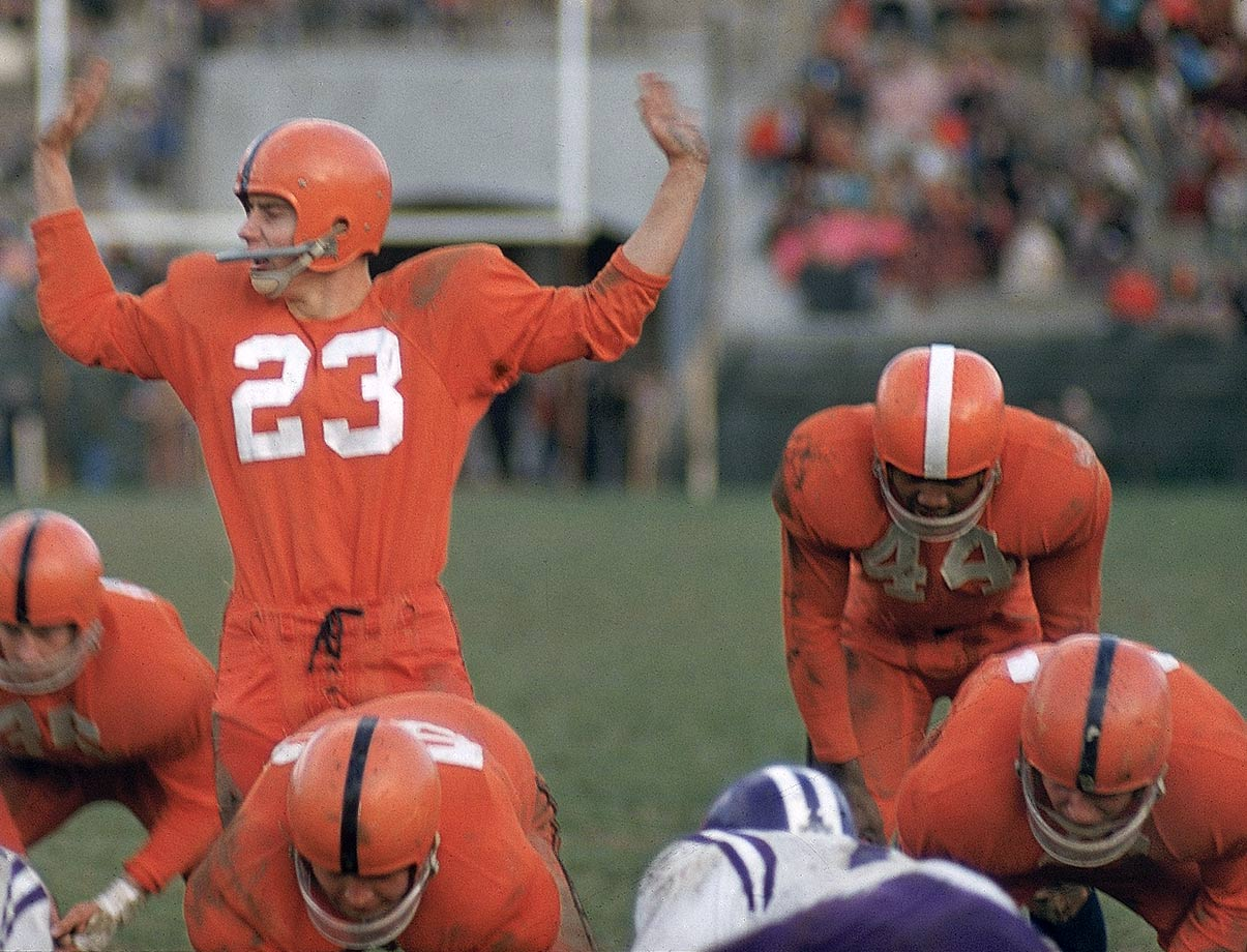 Syracuse quarterback Chuck Zimmerman calls signals alongside Jim Brown at the line of scrimmage during a game against Holy Cross in 1956.