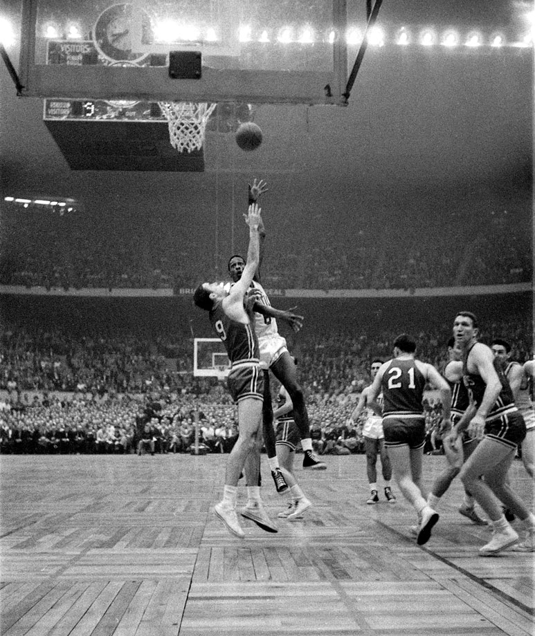 A rookie center named Bill Russell finished with 19 points and 32 rebounds, and fellow rookie Tom Heinsohn had 37 points and 23 rebounds as the Celtics overcame a combined 5-for-40 shooting performance from Bob Cousy and Bill Sharman to prevail 125-123 in double overtime. It was Boston's first NBA championship.