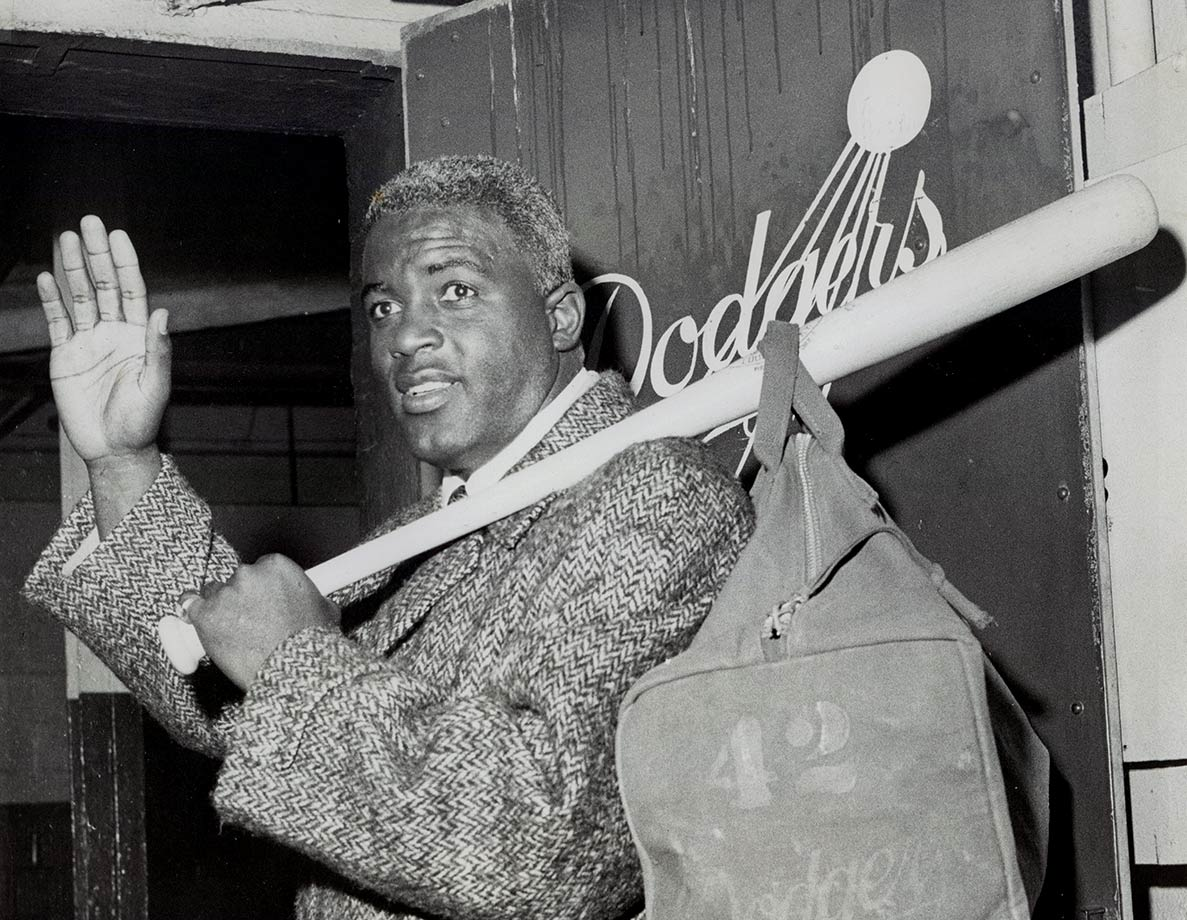 Jackie Robinson waves goodbye as he leaves Ebbets Field for the last time in January 1957. Robins retired at the age of 37, ending his major league career after 10 seasons.