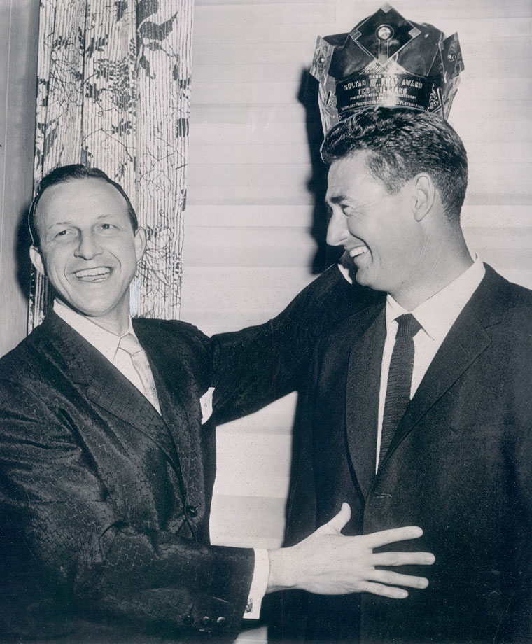 """Stan Musial crowns Ted Williams with the Babe Ruth """"Sultan of Swat"""" Award after Williams won the 1957 batting title."""