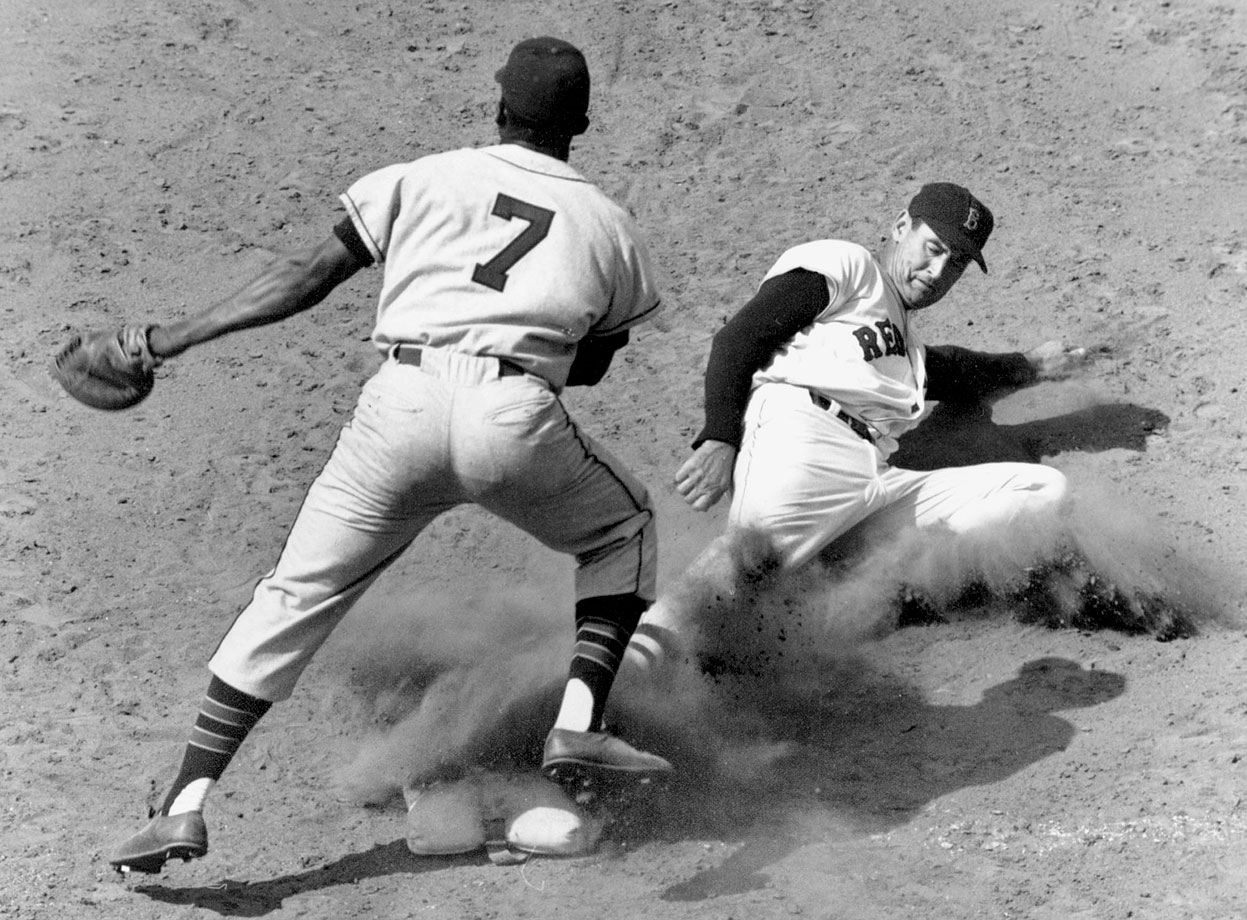 Ted Williams slides into first against Kansas City in 1957.