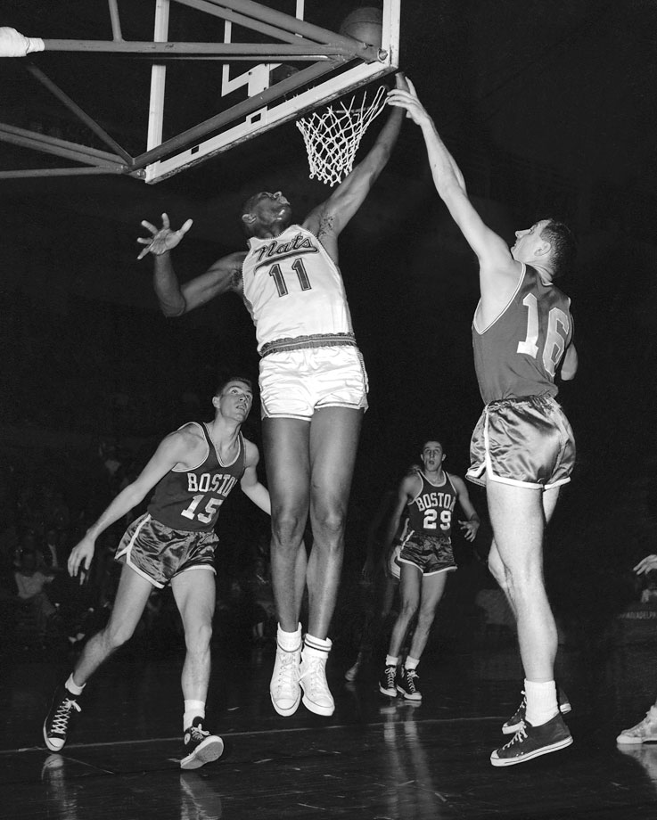 Earl Lloyd shoots a layup against Jack Nichols during a game between the Syracuse Nationals and Boston Celtics in 1958.