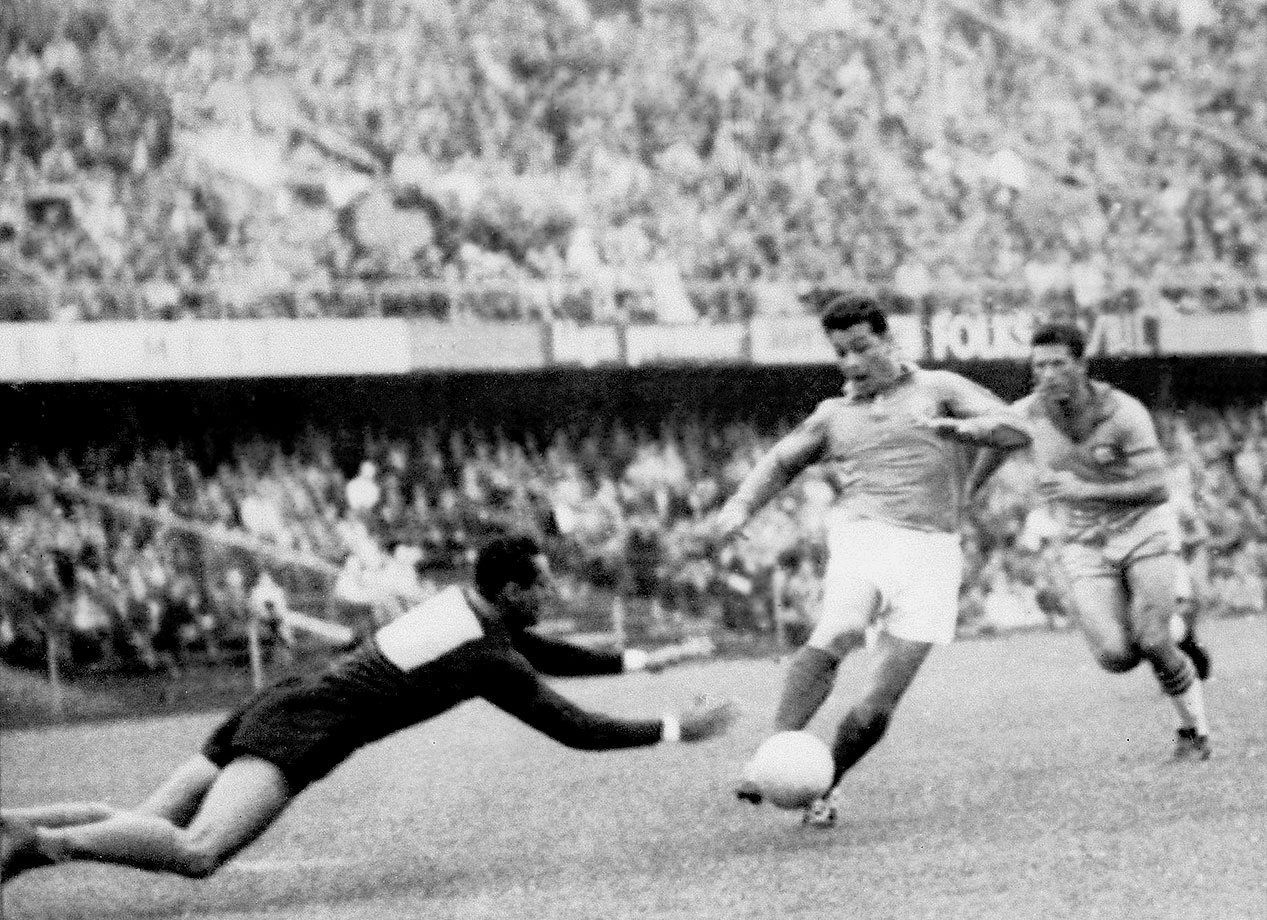 French forward Just Fontaine attempts to dribble past Brazilian goalkeeper Gilmar during a semifinal clash in the 1958 World Cup.