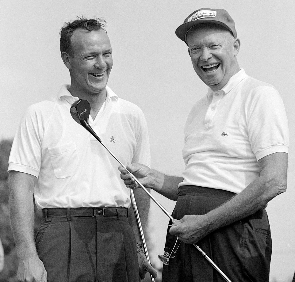 Dwight Eisenhower enjoys a laugh with Arnold Palmer before a round of golf in 1960 at the Gettysburg Country Club in Gettysburg, Penn.