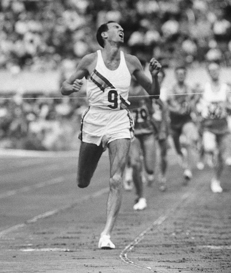 At the 1960 Rome Olympics, Elliott destroyed the competition in the 1,500 by more than 20 meters, breaking his own world record by nearly a half-second in 3:35.6. The record stood for seven years, and his time would have won seven of the next nine Olympic 1,500s.                     That same September, Elliott ran four sub-four-minute miles throughout Europe to bring his three-year total of sub-4s to 17. Elliott was only 22 and had never lost a 1,500 or mile race -- but he had had enough. He never competed in another national or international competition, limiting himself to low-key club races after he enrolled at Cambridge University in England.