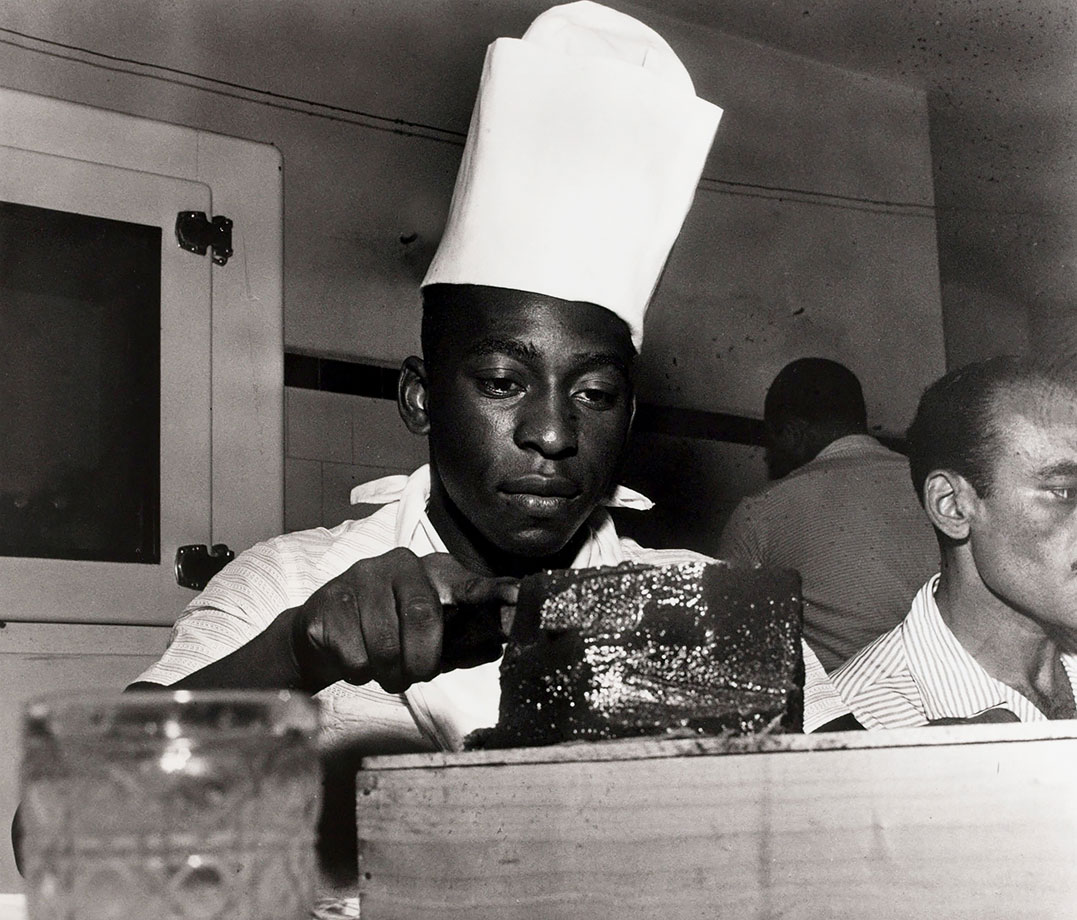 Pelé does some cooking while sporting a chef's hat circa 1960. He certainly knew the recipe for success, netting 1,281 goals during his celebrated career.