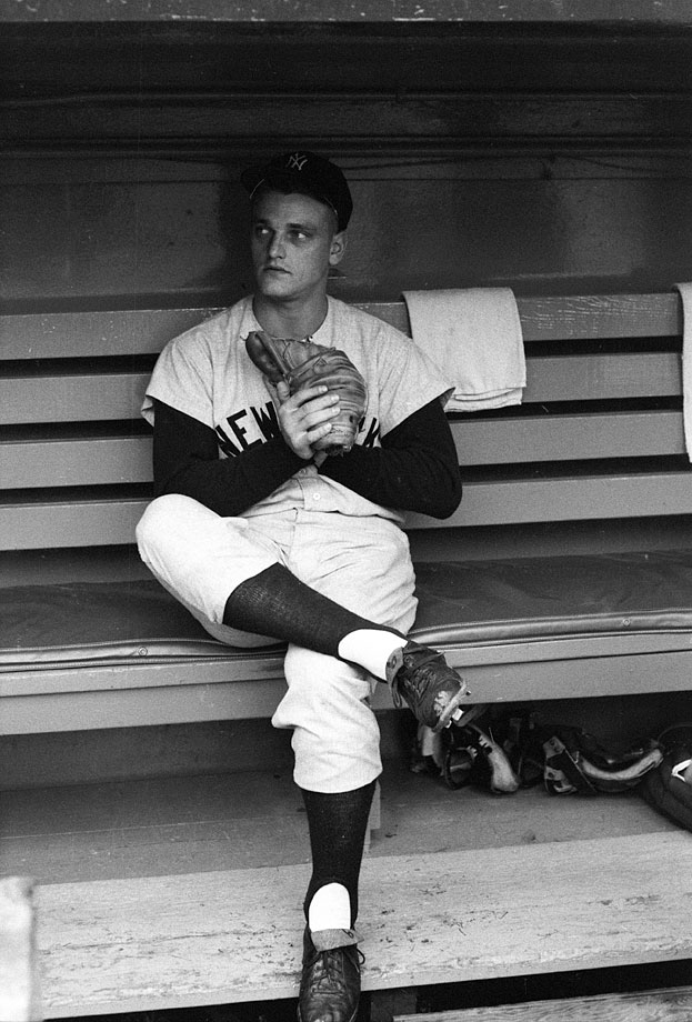 Roger Maris sits in the dugout before Game 2 of the World Series against the Pirates at Forbes Field in Pittsburgh on Oct. 6, 1960.