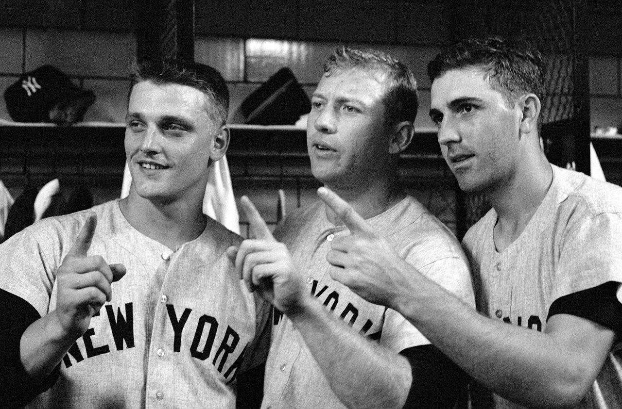 Roger Maris, Mickey Mantle and Clete Boyer gesture the Yankees needing one more game to win the World Series one after winning Game 6 against the Pirates at Forbes Field in Pittsburgh on Oct. 12, 1960.