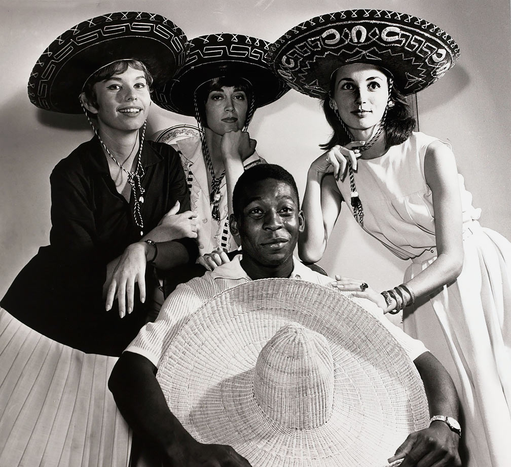 Some female admirers join Pelé in his sombrero photo shoot in March 1961. He had millions of fans, and is still regarded as a Brazilian national hero.