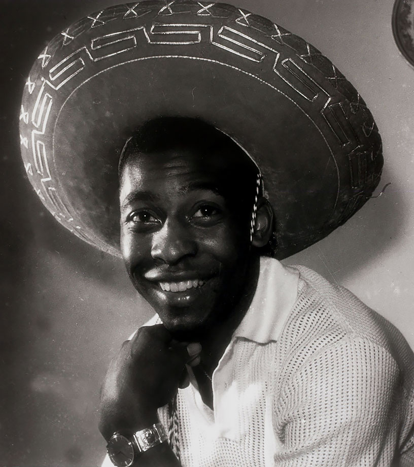 Pelé smiles for the camera while wearing a Mexican-style sombrero in March 1961.