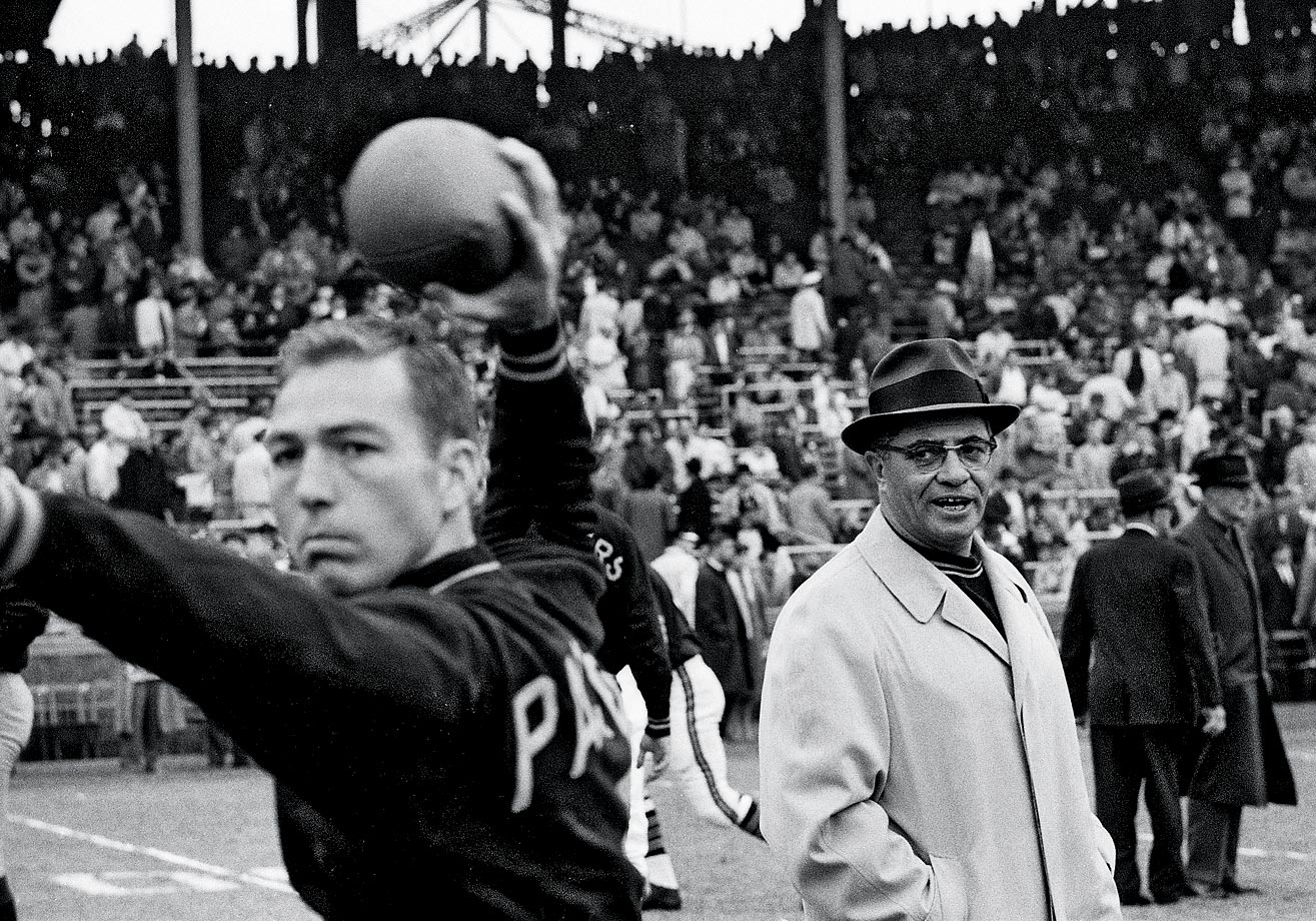 Bart Starr has said that the reason he is in the Hall of Fame is because of his coach, Vince Lombardi, who became the Packers top man three years after Starr entered the league. Together, they won Super Bowl I and Super Bowl II; Starr was the MVP of the game both times. (Text credit: Shannon Carroll)