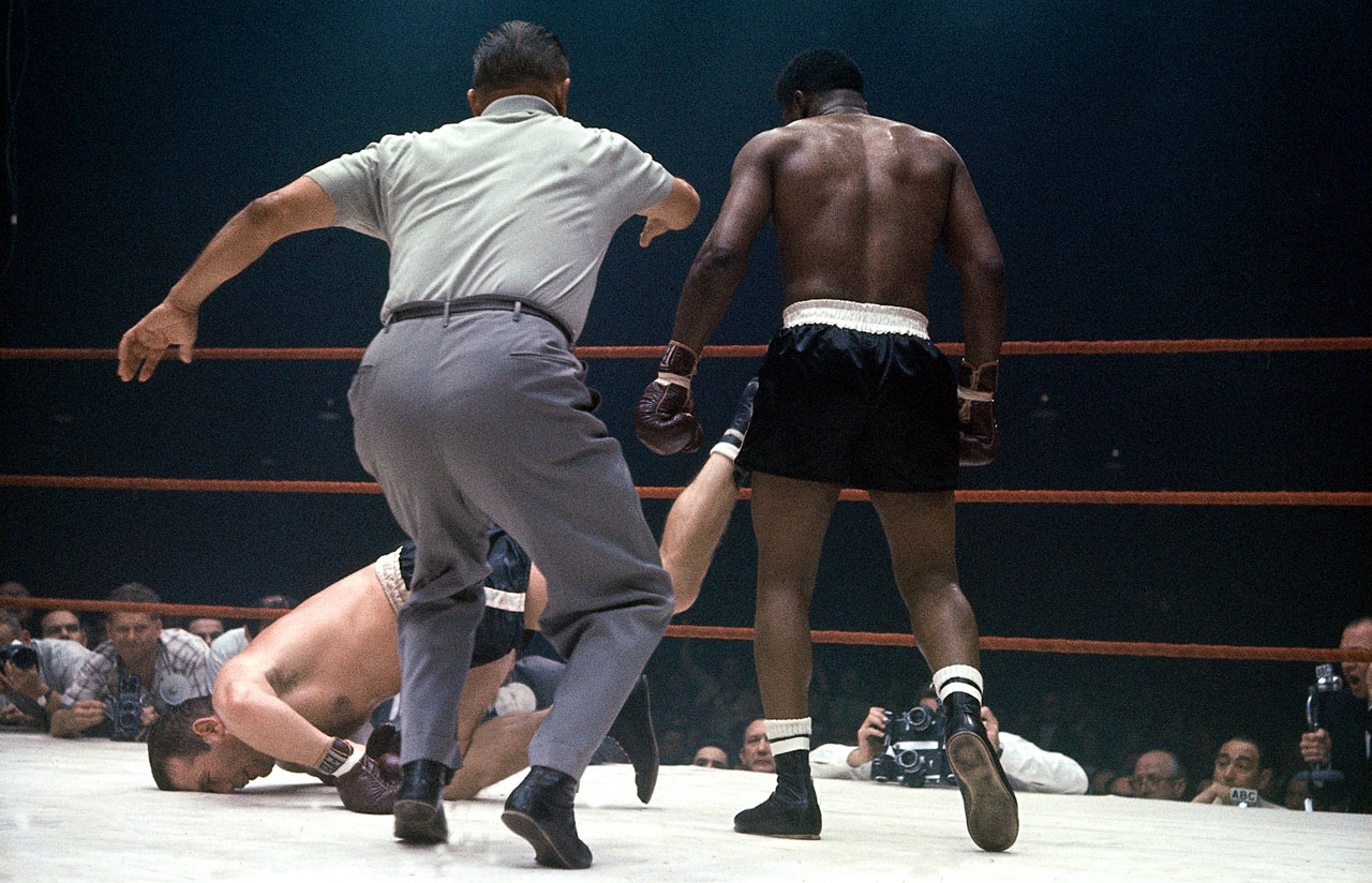 After losing his heavyweight title to Sweden's Johansson on a third-round KO in 1959, Patterson became the first man to regain the crown when he flattened Johansson a year later. Their third fight, held on on March 13, 1961 at Miami Beach's Convention Hall, was a sloppy brawl that ended when Patterson put Ingo down face-first, here, in Round 6. Leifer caught the moment as referee Bill Regan jumped in.