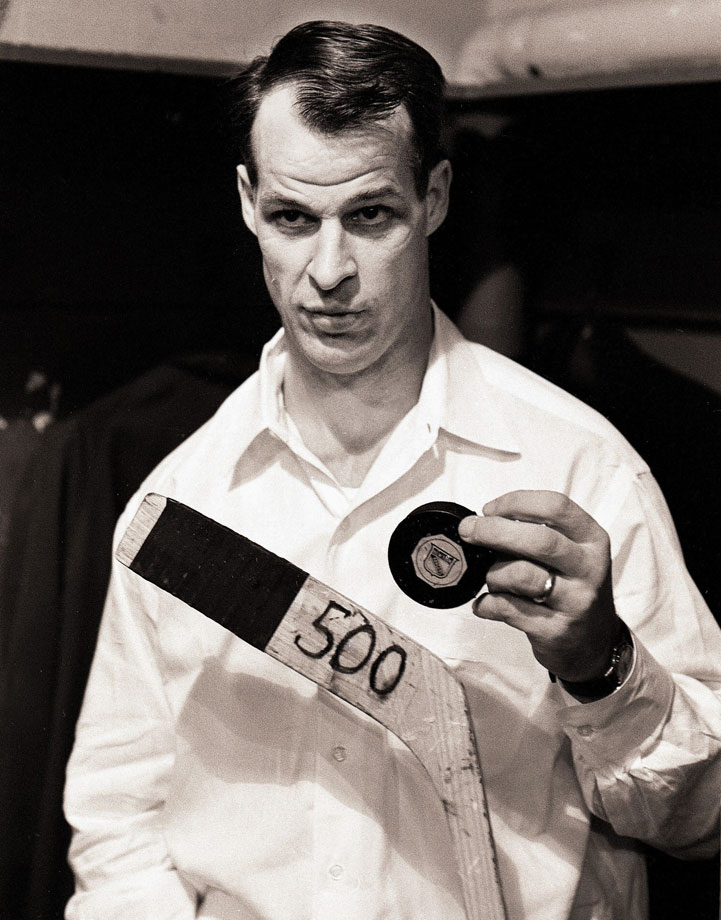Gordie Howe poses with the stick and puck he scored his 500th career goal with following the Detroit Red Wings game against the New York Rangers at Madison Square Garden in New York City.