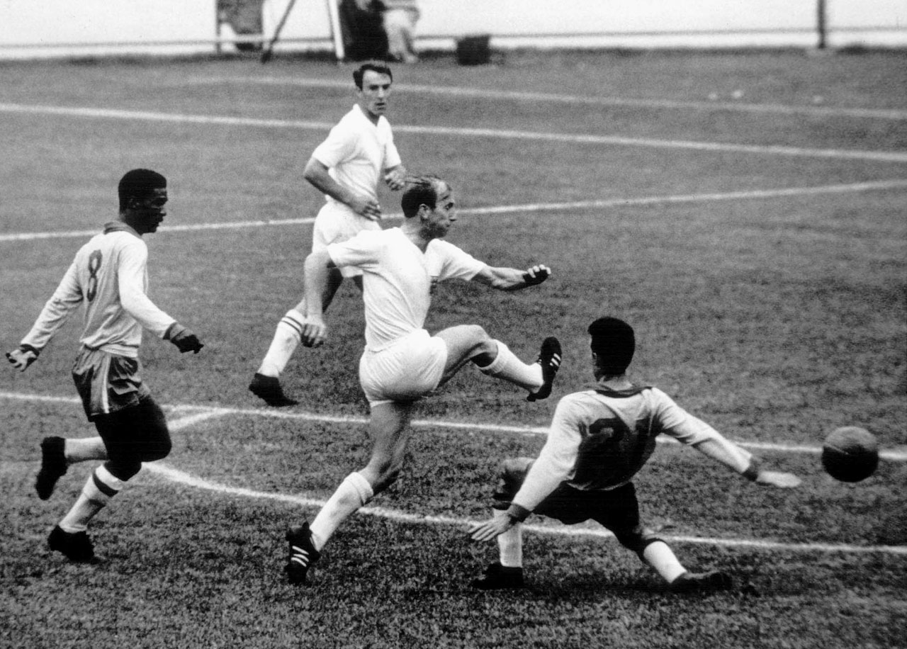 Bobby Charlton shoots despite being defended heavily by Brazilian defenders in the quarterfinal of the 1962 World Cup in Chile.