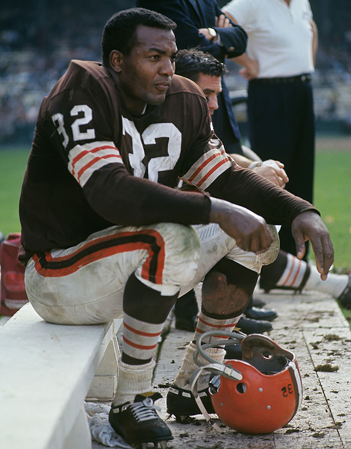 Jim Brown sits on the bench during a game in 1963. He was named the UPI NFL MVP that season after rushing for a career-high 1,863 yards with 12 touchdowns.