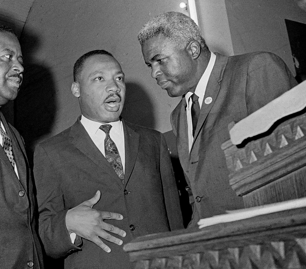 Martin Luther King, Jr. and Jackie Robison discuss race relations in Birmingham, Ala., on May 14, 1963. The men shared a belief in pacifism in the face of intolerance.