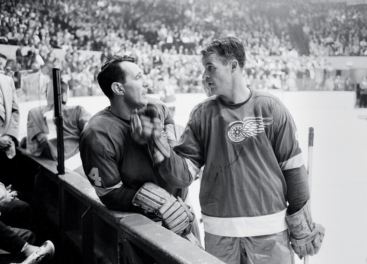 Gordie Howe and Bill Gadsby talk on the ice during a break in the action of a game against the Montreal Canadiens.