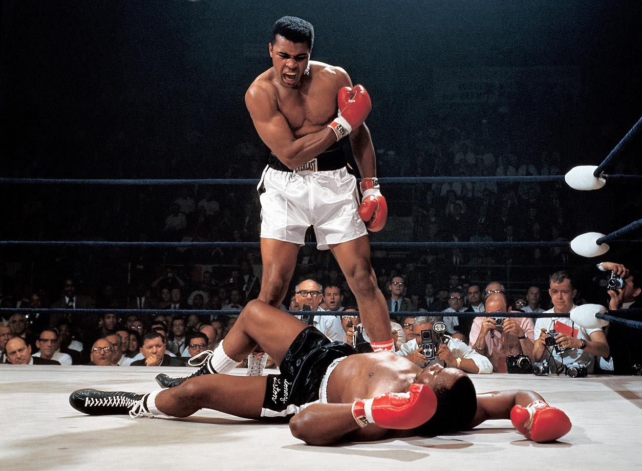 In one of the most iconic and controversial moments of his career, Ali stands over Sonny Liston and yells at him after knocking the former champ down in the first round of their 1965 rematch. Skeptics dubbed it ''the Phantom Punch,'' but films show that Ali's flashing right caught Liston flush, knocking him to the canvas. Refusing to go to a neutral corner, Ali stood over Liston and told him to ''get up and fight, sucker.''