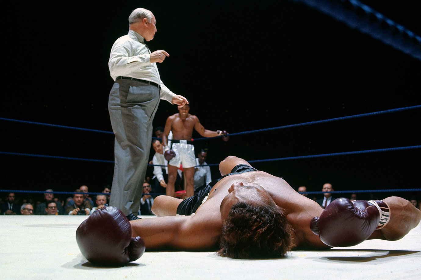Float and sting: In a display of speed and combination punching unmatched in heavyweight history, Ali overwhelmed Williams from the start. The challenger, here down for the third time in round 2, would be saved by the bell before referee Harry Kessler could count him out, but it would only postpone the inevitable.