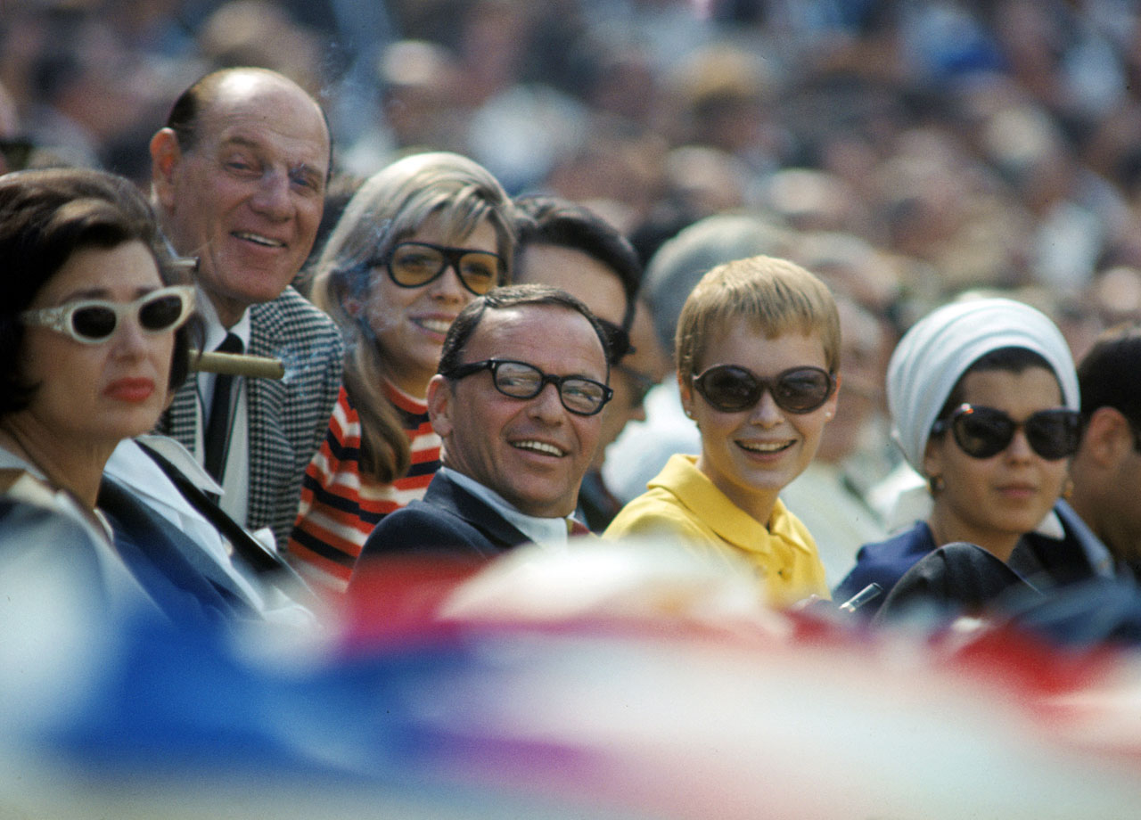 Frank Sinatra and wife Mia Farrow attend Game 1 of the World Series between Los Angeles Dodgers at Dodger Stadium on Oct. 5, 1966.