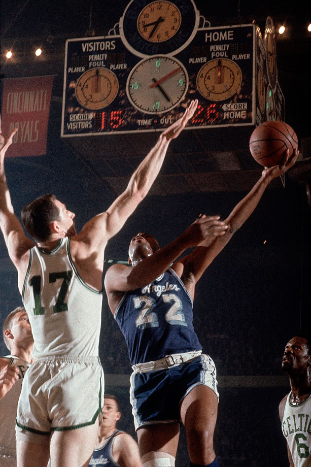 John Havlicek looks to block a shot by Elgin Baylor at Boston Garden. The Celtics defeated the Lakers in seven games to win their eighth consecutive NBA title.