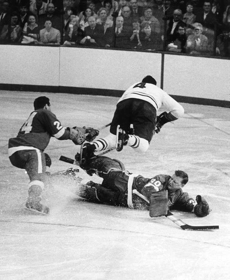Detroit's Roger Crozier, the MVP of the 1966 playoffs, was forced to the sidelines by a wrenched knee in Game 4. His injury proved costly that night as Montreal's flying captain Jean Beliveau beat his backup Hank Bassen, pictured here, to secure a 2-1 victory in the pivotal contest at the Olympia in Detroit. The Habs went on to win the series in six games and clinch their seventh Cup in 11 years.