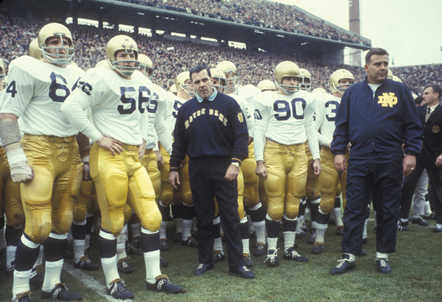 Ara Parseghian, head coach of Notre Dame, on the sidelines with team.