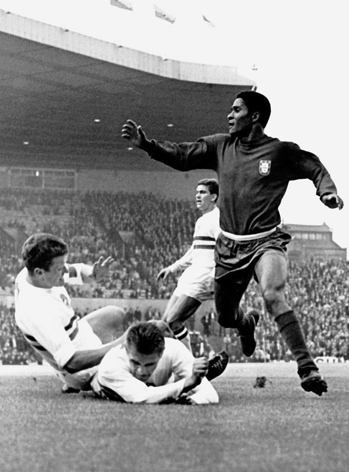 Portuguese legend Eusebio beats the Hungarian defense for a goal in the 1966 World Cup.