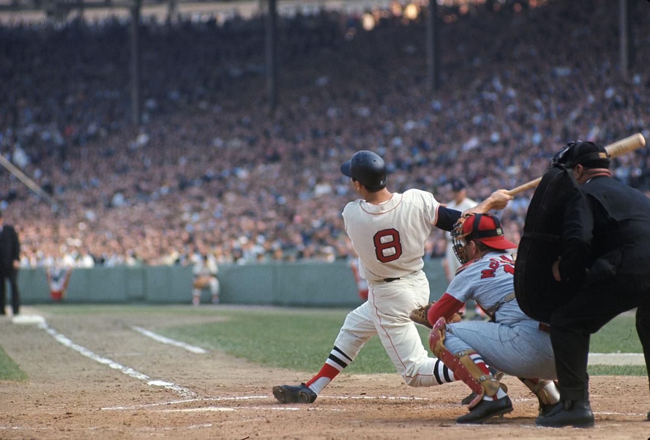 Carl Yastrzemski hits a home run as St. Louis Cardinals catcher Tim McCarver looks on during Game 2 of the World Series on Oct. 5, 1967 at Fenway Park in Boston.