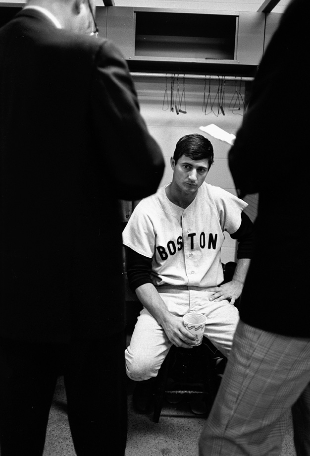 Carl Yastrzemski talks to reporters in the Red Sox locker room after Game 3 of the World Series on Oct. 7, 1967 at Busch Stadium in St. Louis.