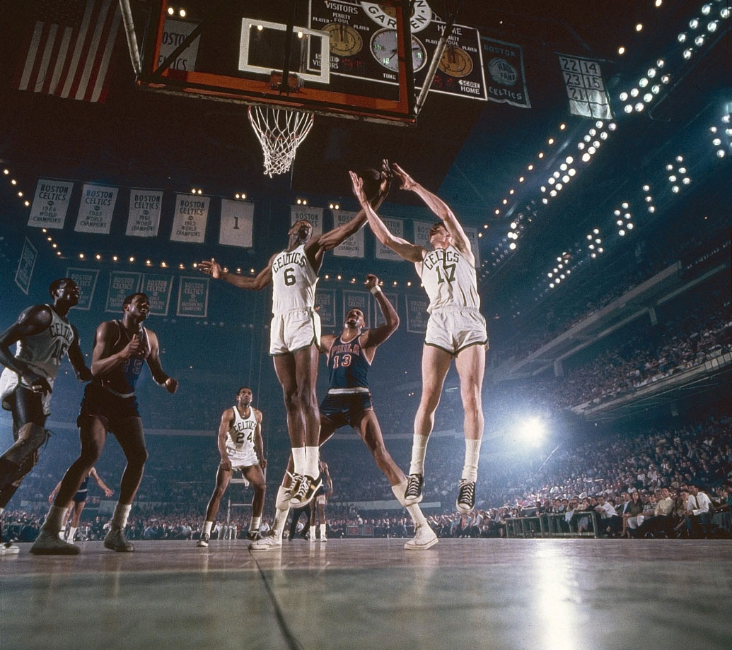 Bill Russell and John Havlicek rebound over Wilt Chamberlain at Boston Garden. The 76ers would end the Celtics' shot at a ninth consecutive title, defeating Boston in the series 4-1. Philadelphia would go to win their first championship, beating San Francisco in six games.
